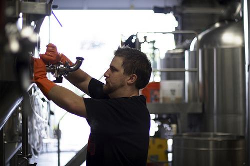 Hopworks Brewer Ben Love doing what he does best