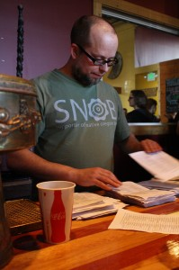 Oregon Brewers Guild's Brian Butenschoen tallies up the votes