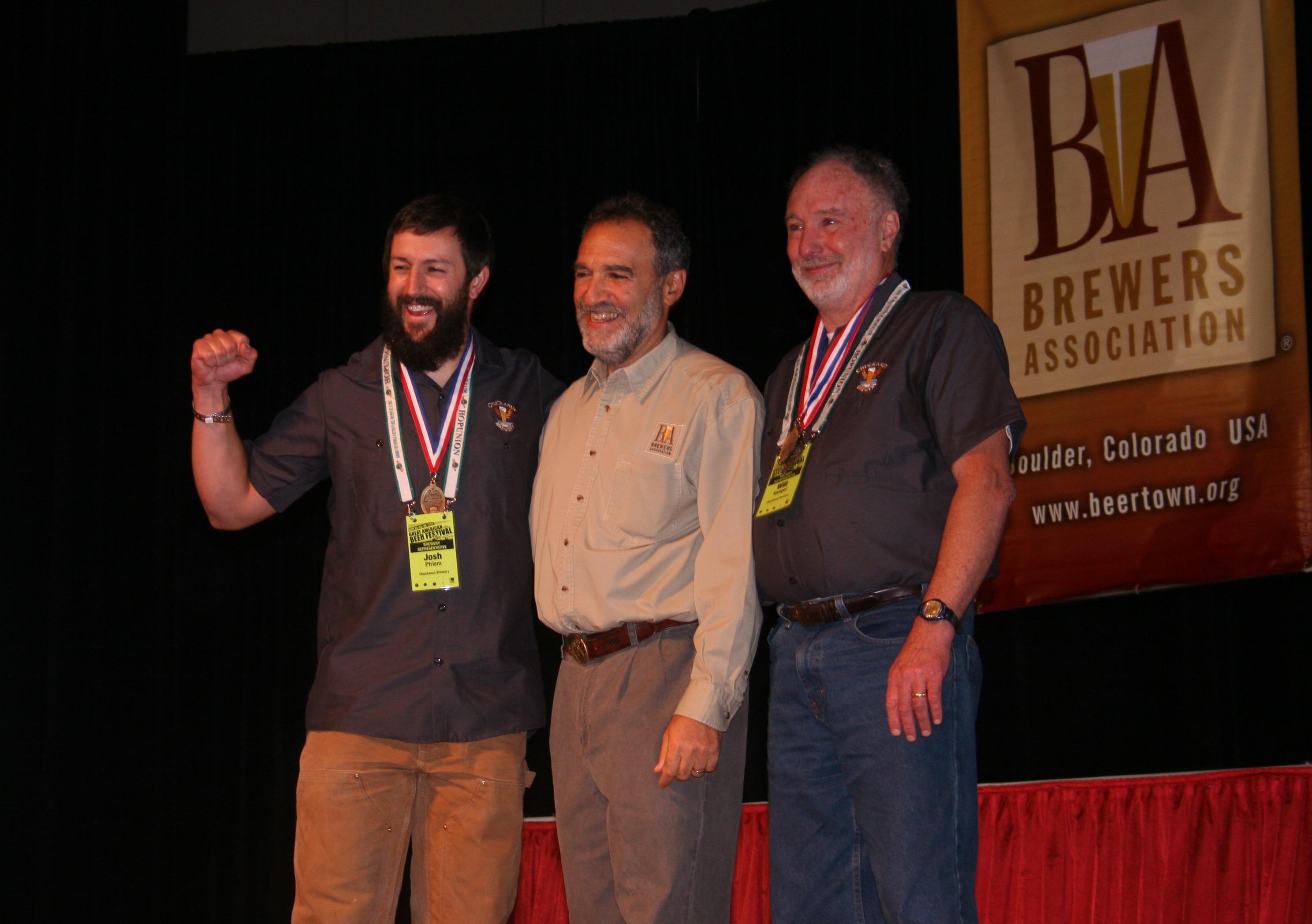 (l to r) Chuckanut lead brewer Josh Pfiem, award guy Charlie Papazian, and Chuckanut brewmaster Will Kemper