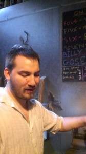 Ezra Johnson-Greenough pours beer at Upright's tasting room