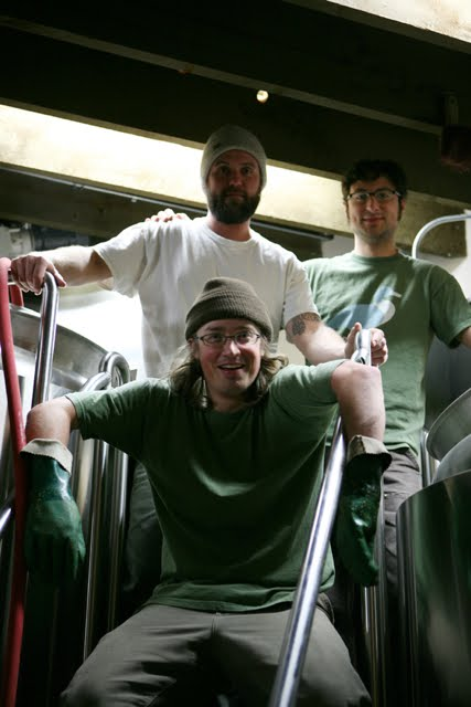 Upright's Gerritt Ill (bottom center), Alchemy's Jason McAdam (top center), and Upright's Alex Ganum collaborate on an oyster stout (photo by Annalou Vincent from Uprightbrewing.com)