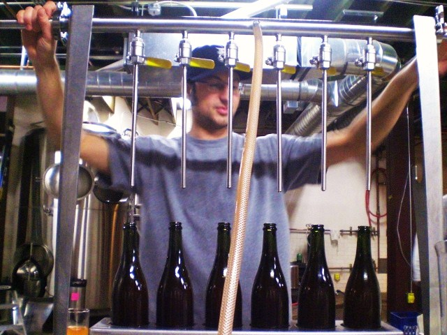 Upright Brewing's Alex Ganum bottling Four Play Ale