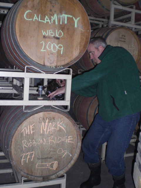 """Mark Vickery taps his wine known as """"the Mark"""" featuring grapes from Ribbon Ridge Vineyards"""