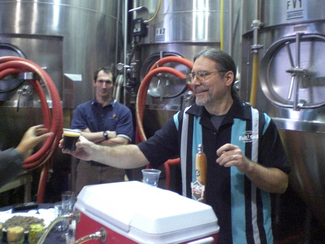 Brewer Phil Roche (right) serves a taste of Full Sail's Collin's Dark Secret developed by packaging manager Collin Godkin (left)