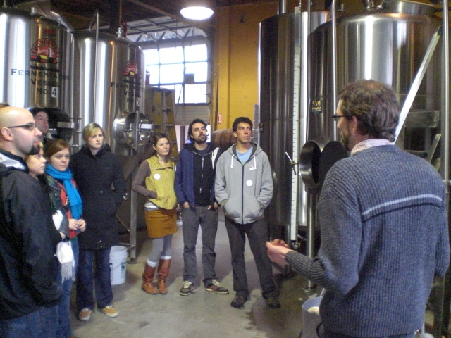 Lucky Lab brewer Ben Flerchinger (right) gives a tour of the brewhouse