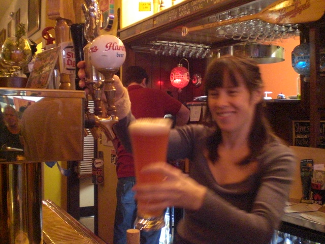 Sarah Pederson, owner of Saraveza pours a Vertigo Razz Wheat at My Beery Valentine