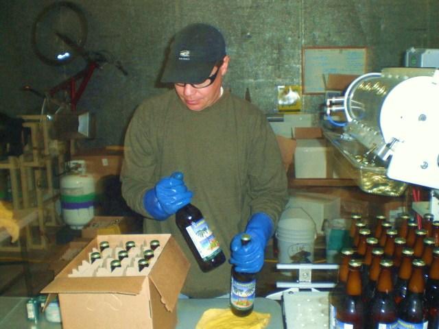 Founder Jim Mills packages Caldera's first bottled beer