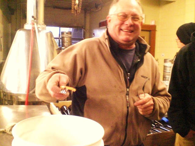 Cascade Brewmaster Ron Gansberg samples hops shoots