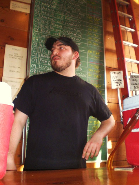 Ezra Johnson-Greenough aka Samurai Artist mans the taps for second shift where Upright's Another Strong Ale pours