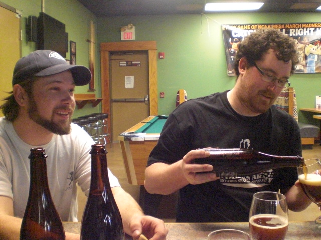 Beck Jensen (left) and Cody Bottorff enjoy the Kriek after a three day bottling run at Cascade Brewing.