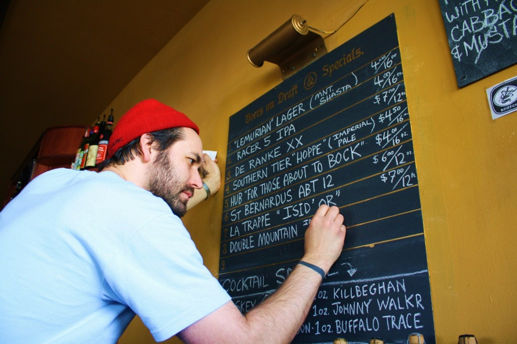 Yoni Laos of Victory Bar adds special beers to the BrewPubliCrawl chalkboard