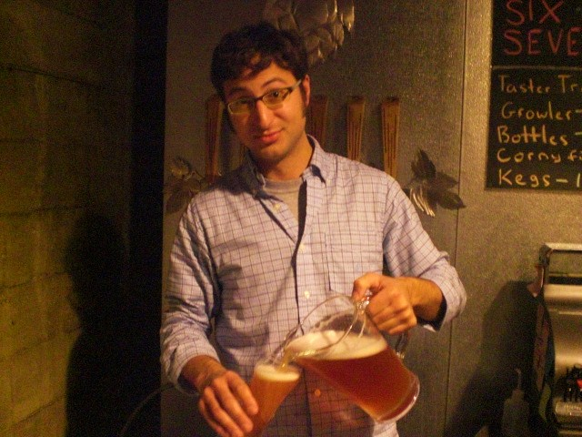 Upright brewmeister Alex Ganum pours some Four Play