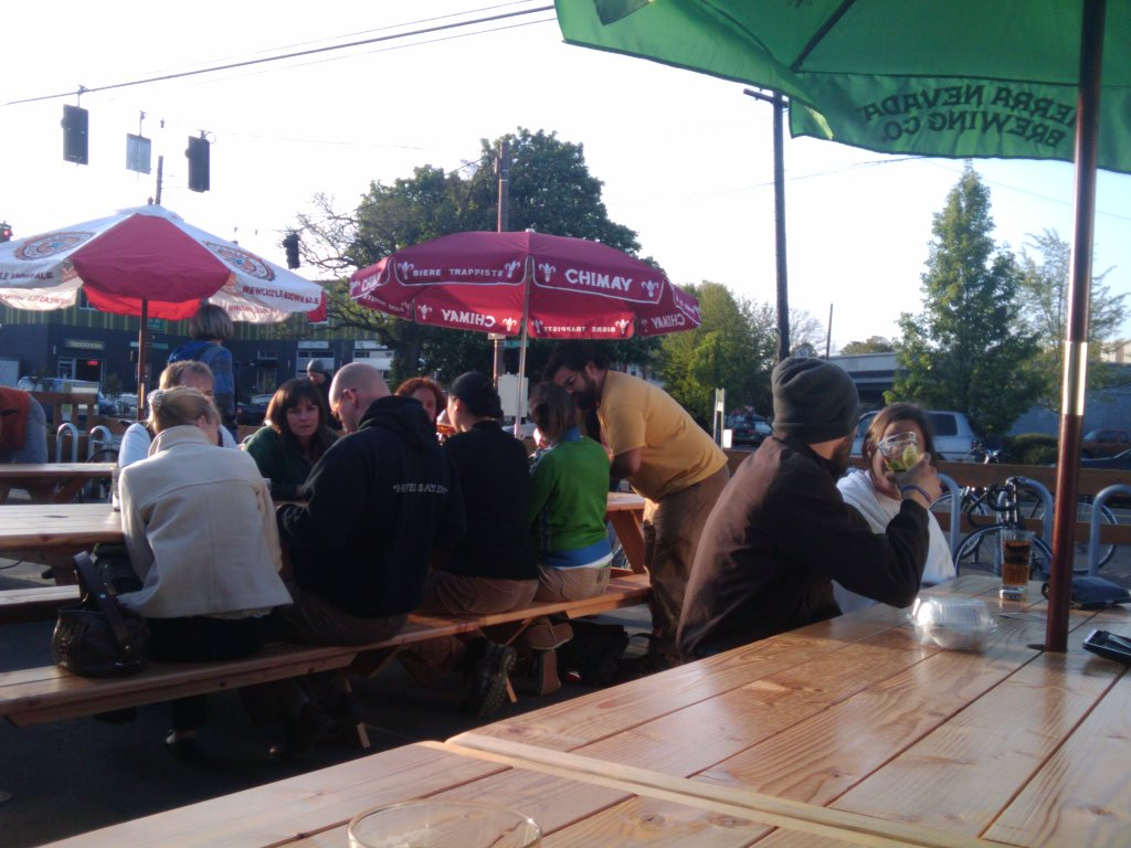 Beer lovers enjoy the sunshine for Apex Bar's soft opening