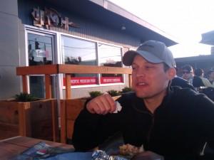 Taplister's Kerry Finsand enjoys a Los Gorditos burrito on Apex Bar's outdoor patio.