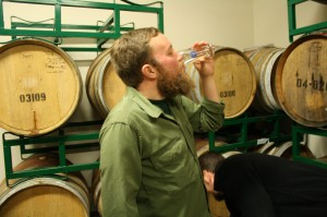 "Tyler ""Elder"" Vickers in the Oakshire barrel room"
