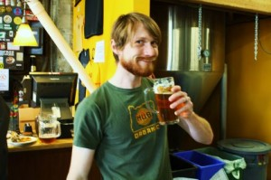 "Hopworks Brewer Matt ""Speck"" Speckenbach enjoys a taste of HUB's Gigabit IPA"