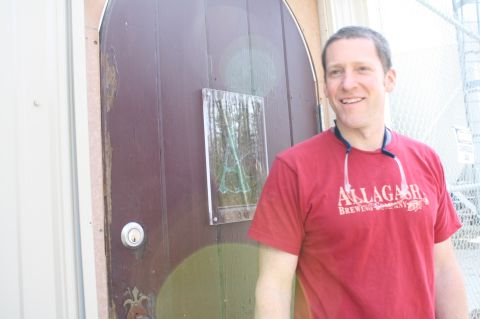 Allagash brewmaster Jason Perkins by the door to the Koelschip room