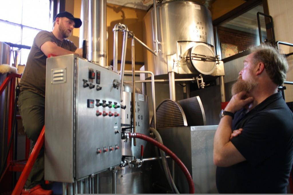 Assistant brewer Tyler Jones( (left) and brewmaster Tod Mott