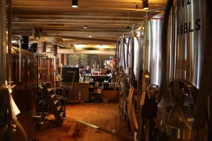 Fermenters behind the bar at Milly's Tavern