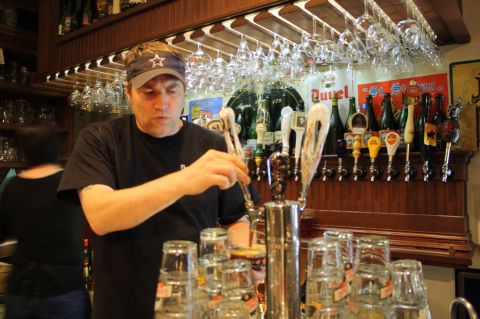 Ebenezer's owner Chris Lively pours a beer