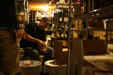 Chris Lively taps a keg of Allagash Koelschip blend #9 in Ebenezer's cellar