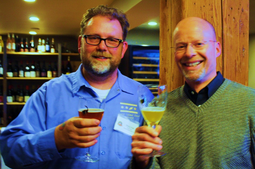 Goose Island Brewmaster Greg Hall (left) enjoys a beer with Widmer co-founder Rob Widmer