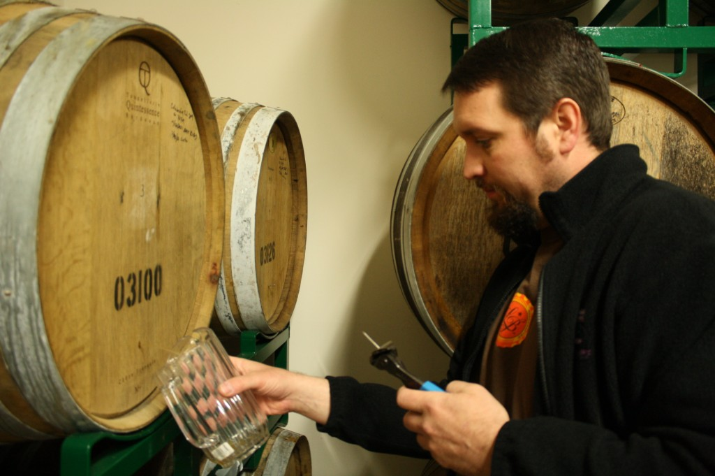 Matt Van Wyk pours some barrel-aged sours at Oakshire's barrel room in Eugene, Oregon