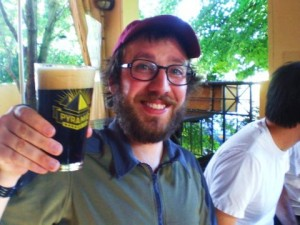 Angelo enjoys a pint of Pyramid Discord Dark IPA at MacTarnahan's Taproom.