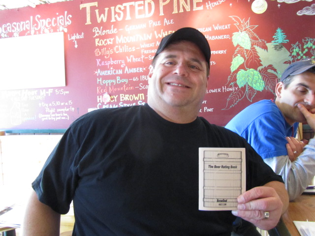 BrewDad's Mike Besser shows his beer rating book he put together and used at the Twisted Pine