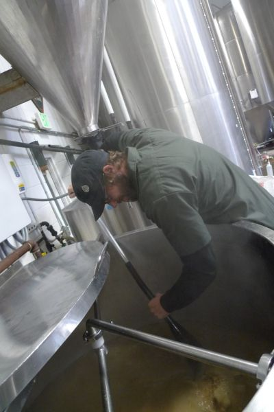 Joe Mohrfeld cutting the mash bed at Odell's Brewery