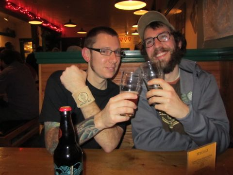 Jacob Leonard (left) raises a glass with Brewpublic's Angelo at Walking Man's 10th Anniversary celebration