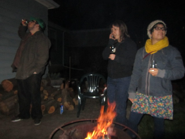 Jason, Margaret, and Elsa keep warm by the fire