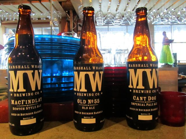 Three Barrel-aged bottles from Marshall Wharf: MacFindlay Scotch Ale, Old No. 55, and Cant Dog Imperial Pale Ale
