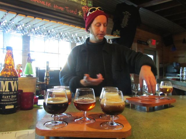 Dave Carlson sets up a sampler tray of Marshall Wharf brews at Three Tides in Belfast, Maine