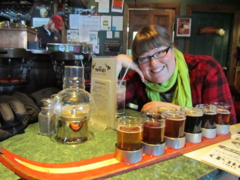Jessie with a sampler ski tray at The Shed Restaurant & Brewery
