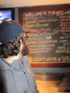 Angelo observes taplist at Portsmouth Brewery