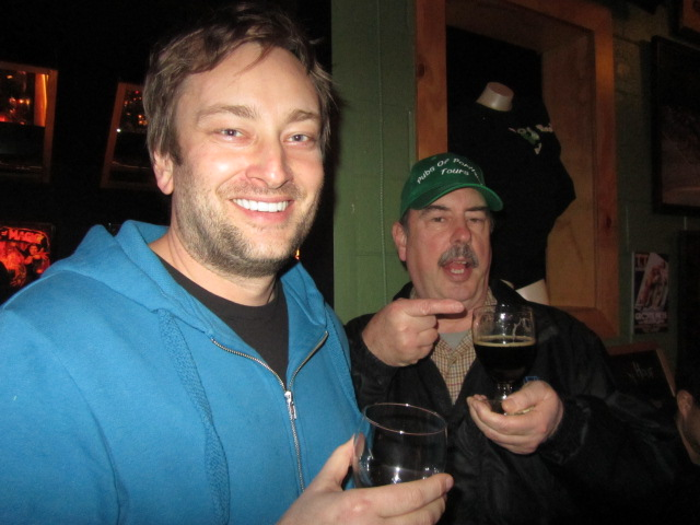 Roscoe's Jeremy Lewis (left) enjoys a beer with Marc Martin of Pubs of Portland Tours