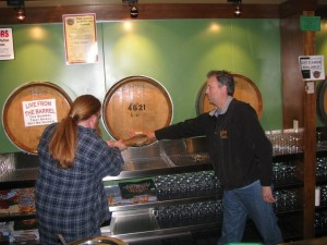 "Charles ""Big Hammer"" Culp taps the barrel at Cascade Brewing Barrel House with Preston Weesner"