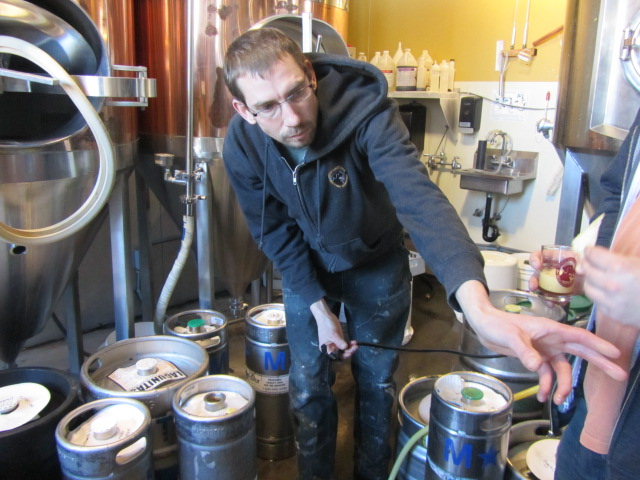 Lucky Lab Brewer Ben Flerchinger pours tastes of big brews in the brewhouse