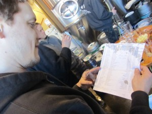 Lucky Lab's Casey Lyons inspects the list of barleywines and big beers