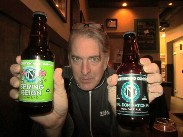 Ninkasi's Morgan Miller with 12-ounce bottles of Spring Reign and Total Domination