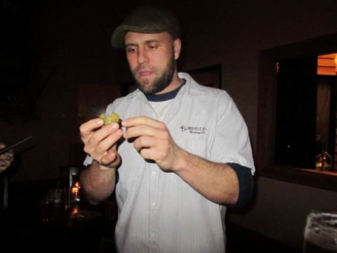 Burnside Brewmaster Jason McAdam inspects a Jamaican Scotch Bonnet Pepper