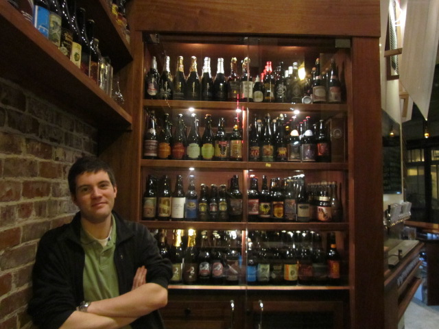 Michael O'Connor of Bailey's Taproom next to their fine bottle selection