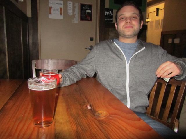 Elan Walsky of Coalition Brewing enjoying a pint