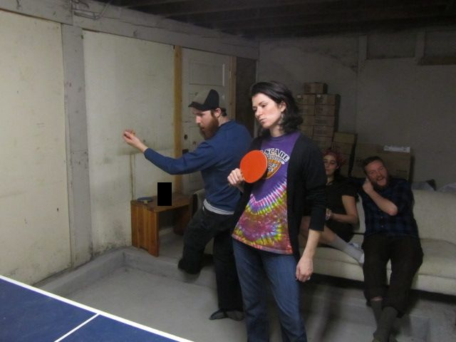 Neil Yandow and Amber King play doubles while Tyler The Elder inspects