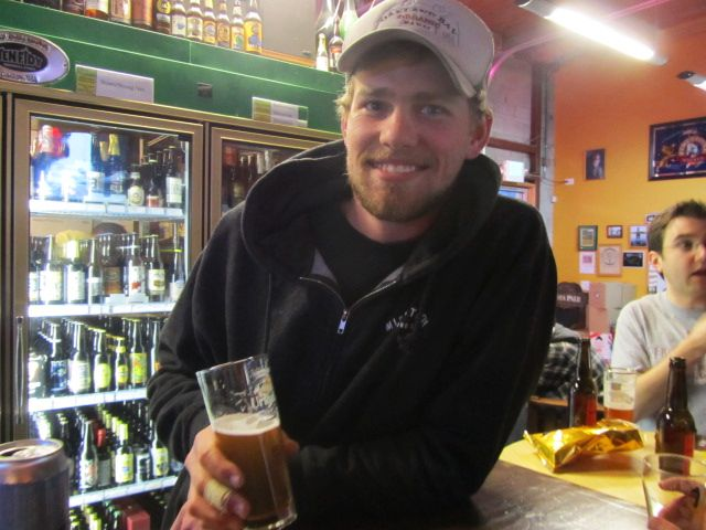 Migration Brewer Michael Branes with a glass of Clem's Cream Ale at The BeerMongers