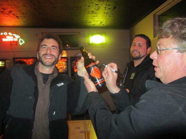 Amnesia brewer Chris Spollen (left) gets an autograph from Walkabout owner/brewer Ross Litton (right) as Oakshire brewer Matt Van Wyk looks on.