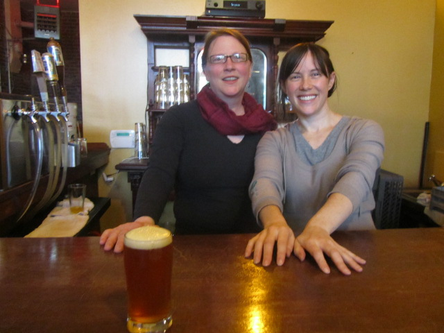 Saraveza's Kate Vincent (left) and Sarah Pederson with a glass of Russian River Pliny the Younger
