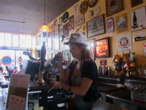 Belmont Station's Holly Emery draws Union Local 180's ESB from the cask