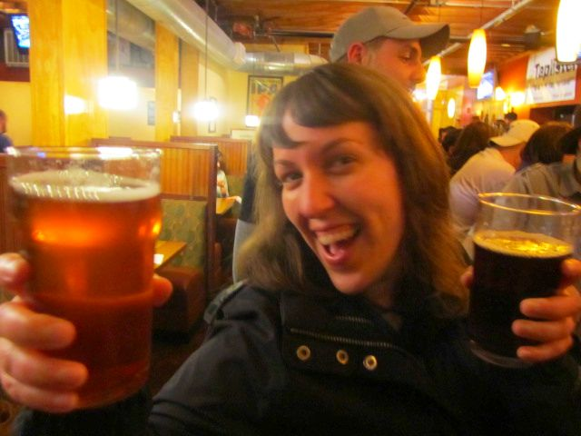 Brewpublic's Margaret Lut raises two beers at Laurelwood's 10th Anniversary Party